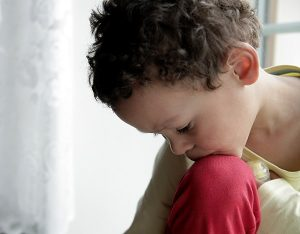 A boy appears sad