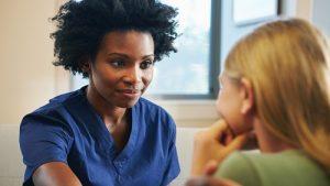 Woman counseling female